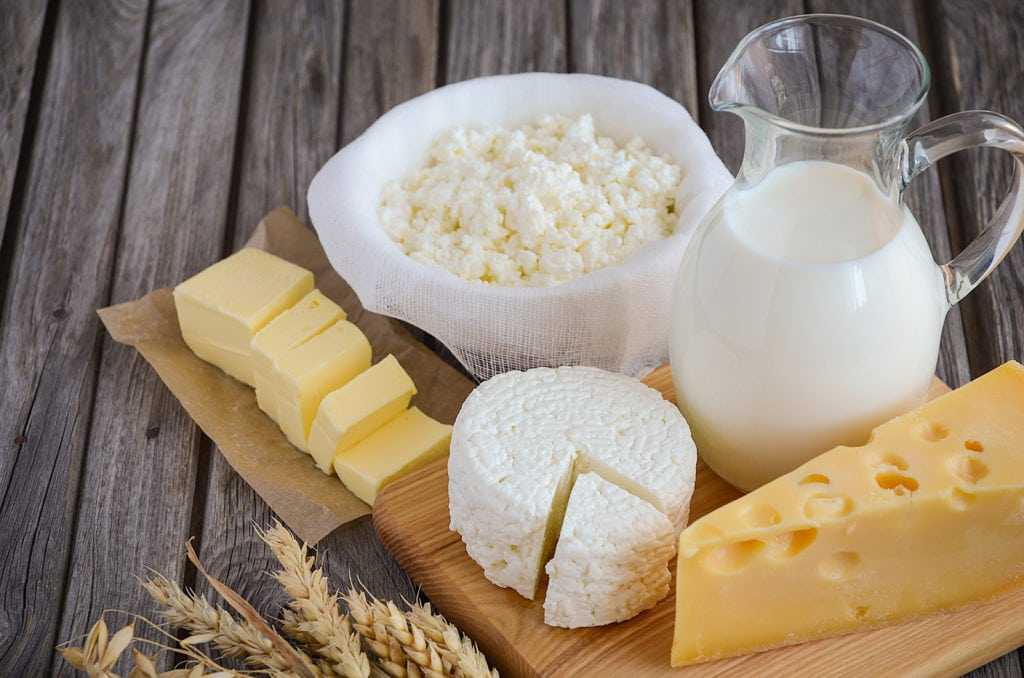 Fresh dairy products. Milk, cheese, butter and cottage cheese with wheat on the rustic wooden background. Horizontal permission. Selective focus. Copy space. ** Note: Soft Focus at 100%, best at smaller sizes