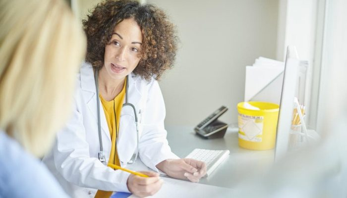 female-doctor-in-office-speaking-to-patient