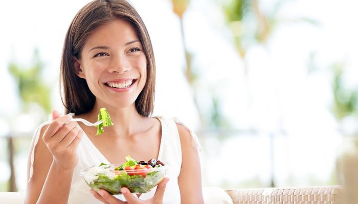 happy-woman-eating-salad (1)