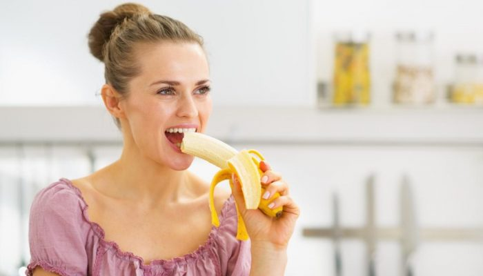 woman-eating-a-banana